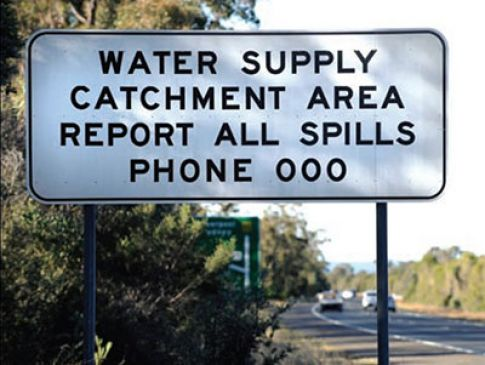 a sign calling on all spills to be reported