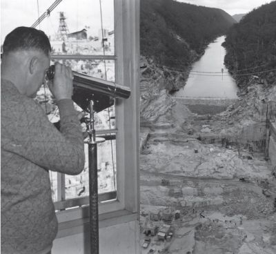 A man looks through a telescope at the gorge