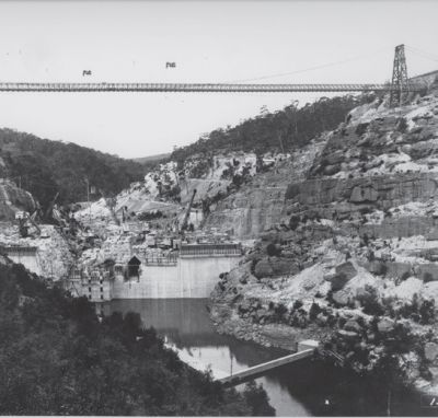 old photo of a bridge across the gorge at the site of the Nepean Dam