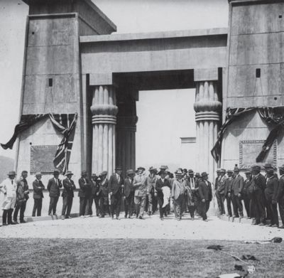 many people standing under the gates of cordeaux dam in an old photograph