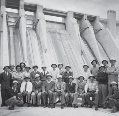 a photo of the engineers in front of the dam wall