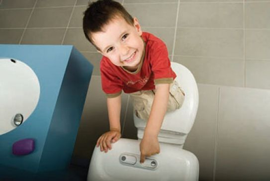 Child flushing a toilet
