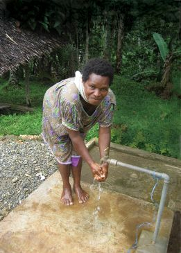 Child using tap in PNG