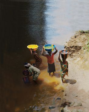 Women in Liberia collecting river water