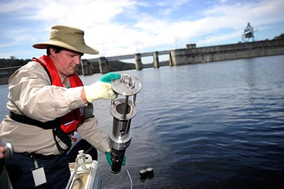 officer testing water quality