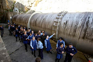 Students with the Warragamba pipeline