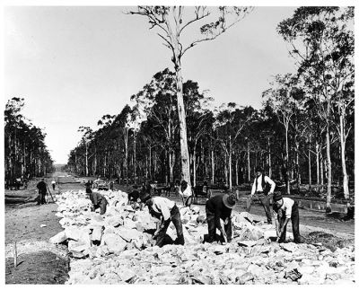 Men building road by hand